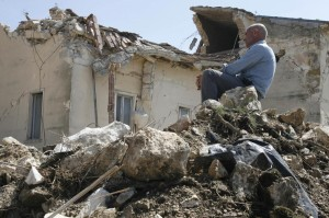 "FILE - In this April 7, 2009 file photo a man sits on rubbles in the village of Onna, a day after a powerful earthquake struck the Abruzzo region in central Italy. An Italian court Monday, Oct. 22, 2012 has convicted seven scientists and experts of manslaughter for failing to adequately warn citizens before an earthquake struck central Italy in 2009, killing more than 300 people. The court in L'Aquila Monday evening handed down the convictions and six-year-prison sentences to the defendants, members of a national ""Great Risks Commission."" In Italy, convictions aren't definitive until after at least one level of appeals, so it is unlikely any of the defendants would face jail immediately. Scientists worldwide had decried the trial as ridiculous, contending that science has no way to predict quakes. (AP Photo/Alessandra Tarantino, File)"